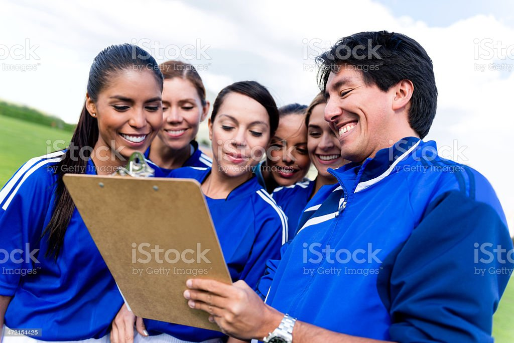 Coach with a football team stock photo