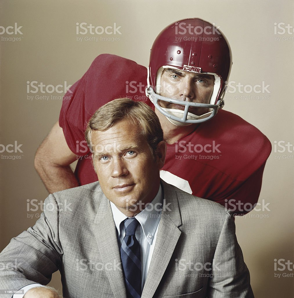 Coach with American football player, portrait royalty-free stock photo