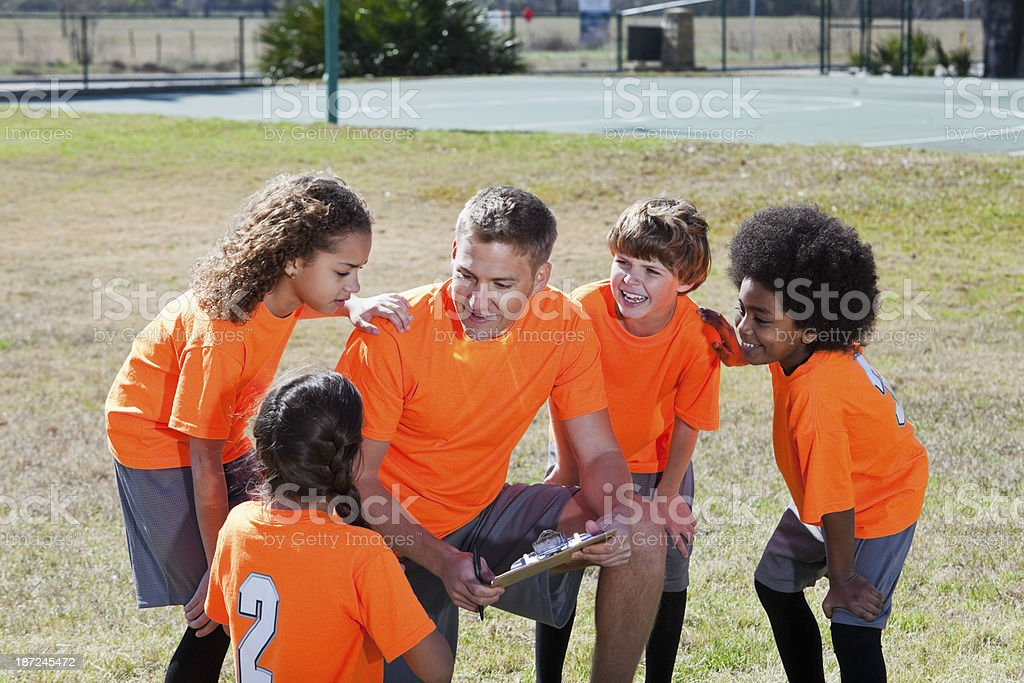 Coach with children's sports team stock photo