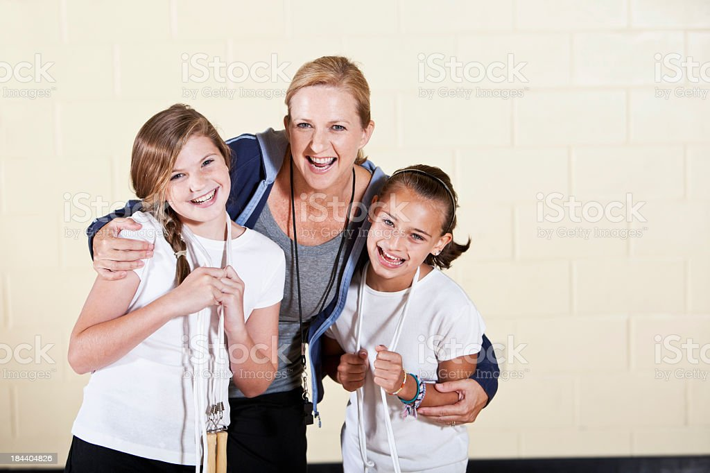 Coach with girls in gym class royalty-free stock photo