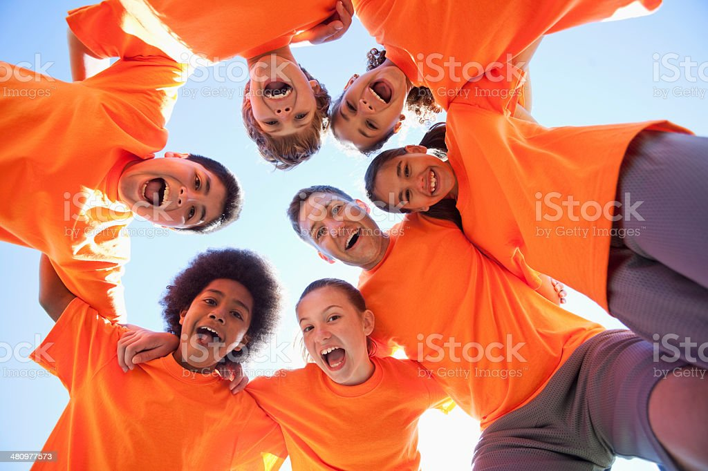 Coach with group of children stock photo