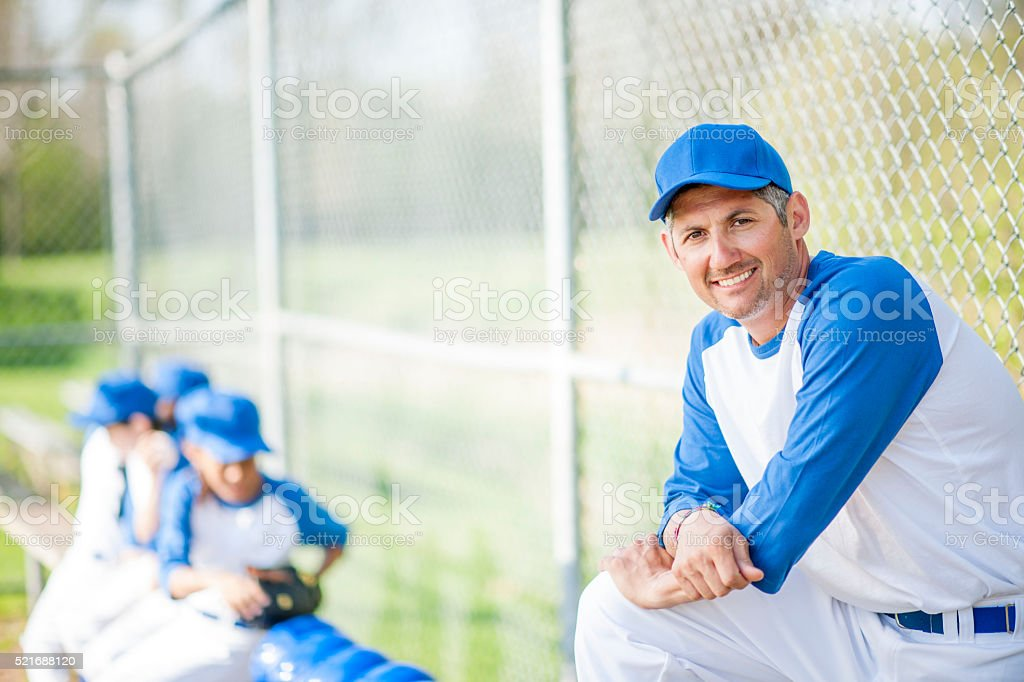 Coach with His Team in the Dug Out stock photo