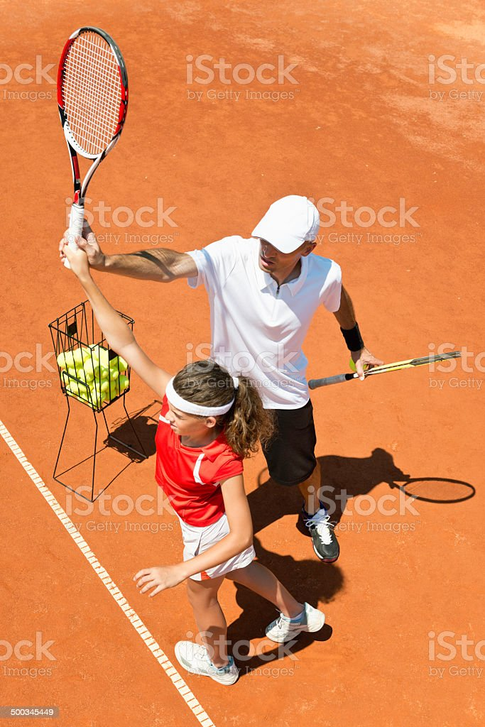 Coach with junior female tennis player royalty-free stock photo