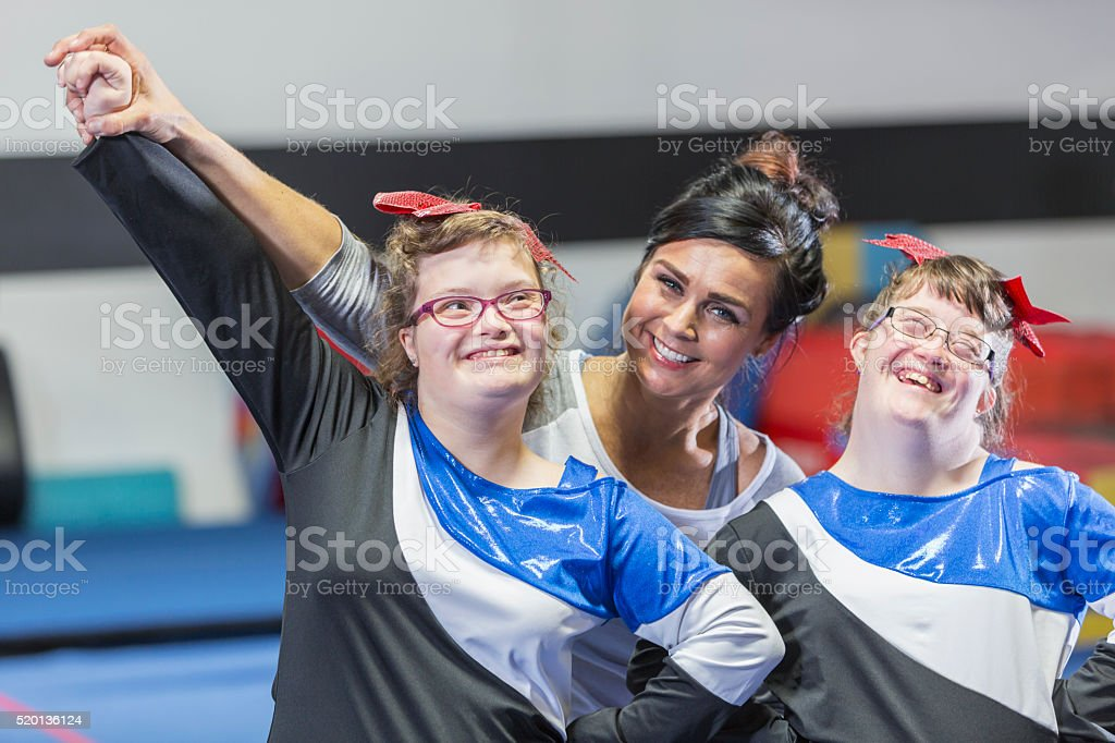 Coach with special needs cheerleading squad stock photo