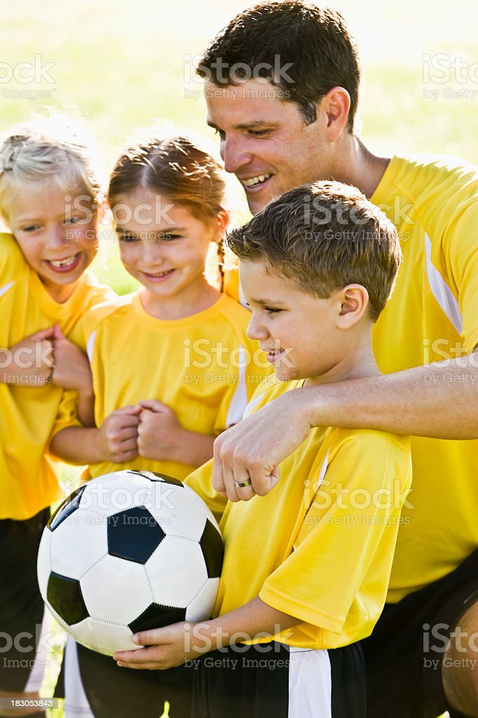Coach with young team of soccer players royalty-free stock photo