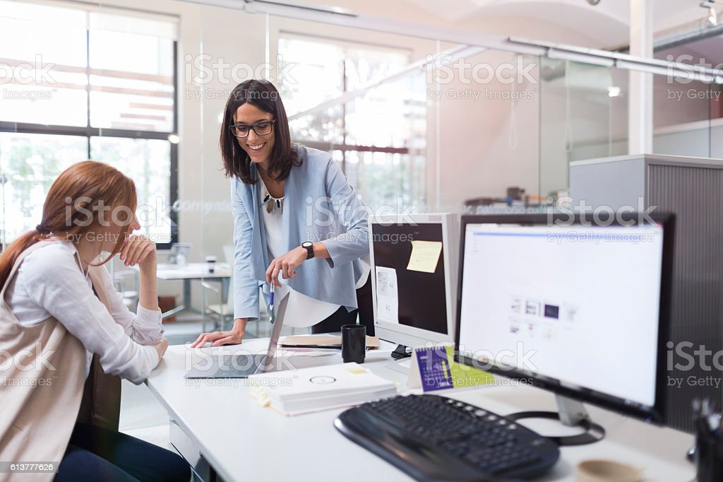 Coaching and advise, two business woman working together. stock photo