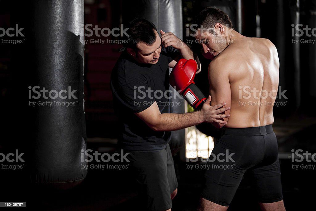 Coaching boxer at a gym royalty-free stock photo