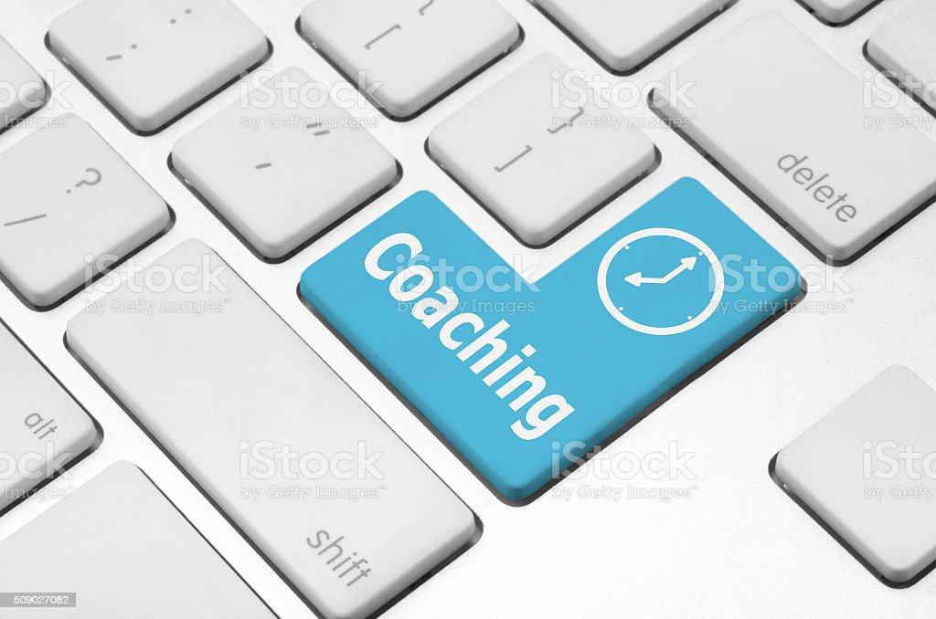 Coaching key on the computer keyboard stock photo