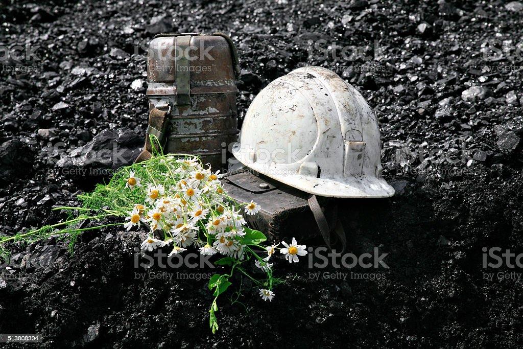 Coal and helmet stock photo
