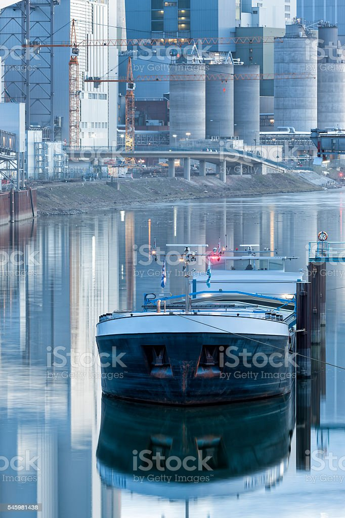 Coal Barge and Power Plant at Dusk, Germany stock photo
