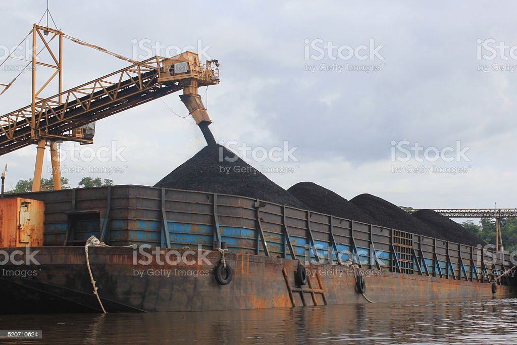 Coal barge loading process on the river stock photo
