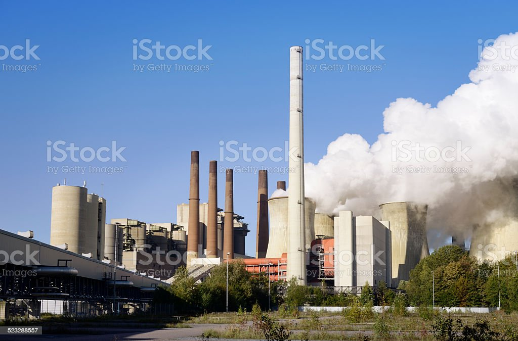 Coal burning power plant with pollution stock photo