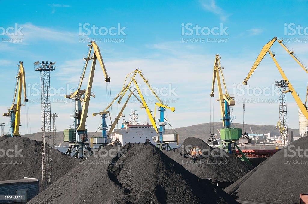 Coal, cranes, cargo ship. stock photo