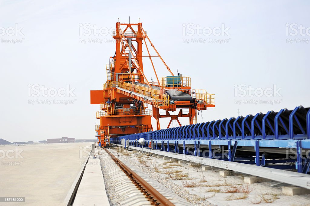 A coal export plant in blue and orange royalty-free stock photo