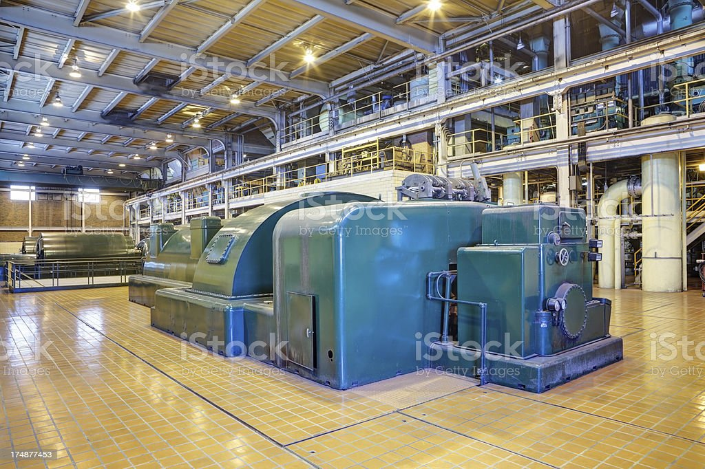 Coal Fired Power Plant Interior with 100 Megawatt Turbines stock photo