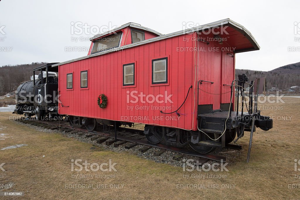 Coal fired steam engine with red caboose, Groveton, New Hampshire. stock photo