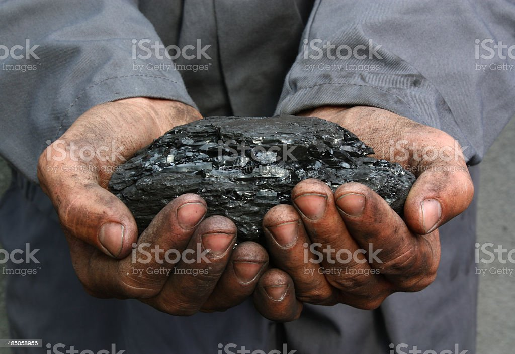 Coal in hands stock photo