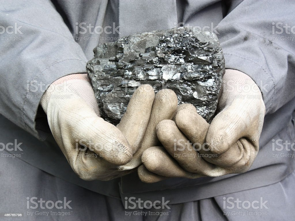Coal in the hands stock photo