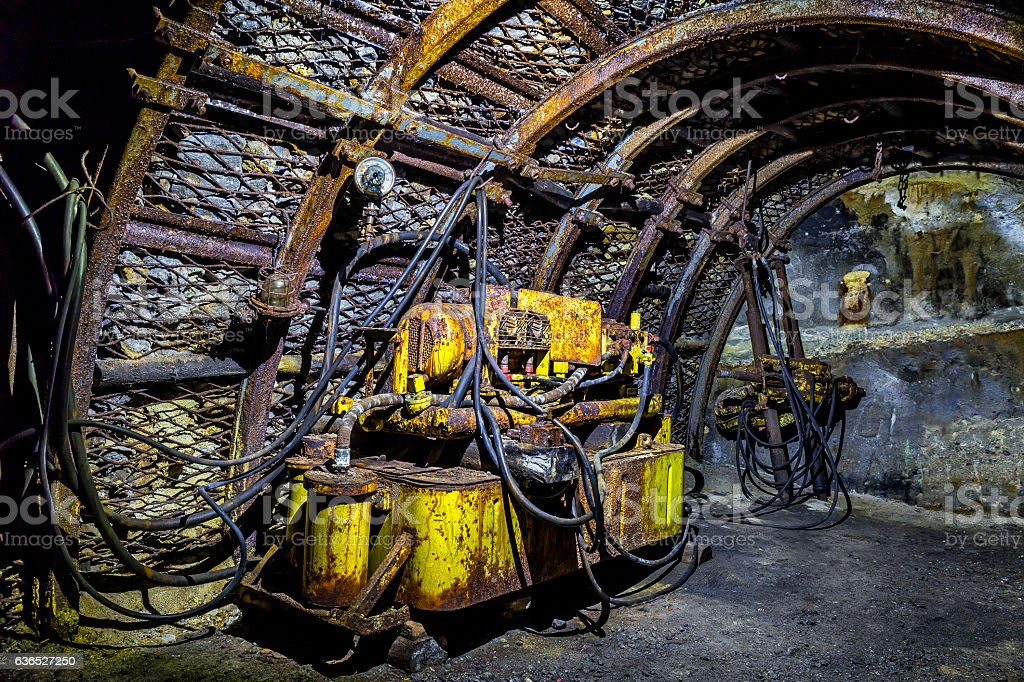 Coal mine corridor with support system and electrical machines stock photo