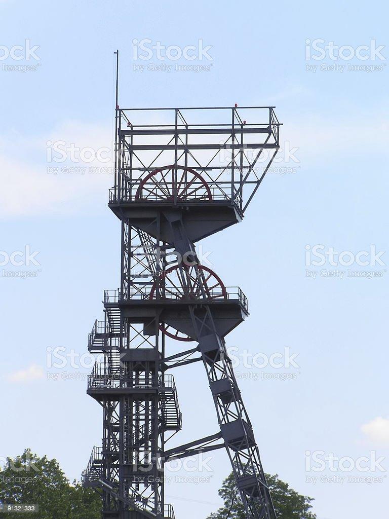 coal mine - elevator tower on background of blue sky stock photo