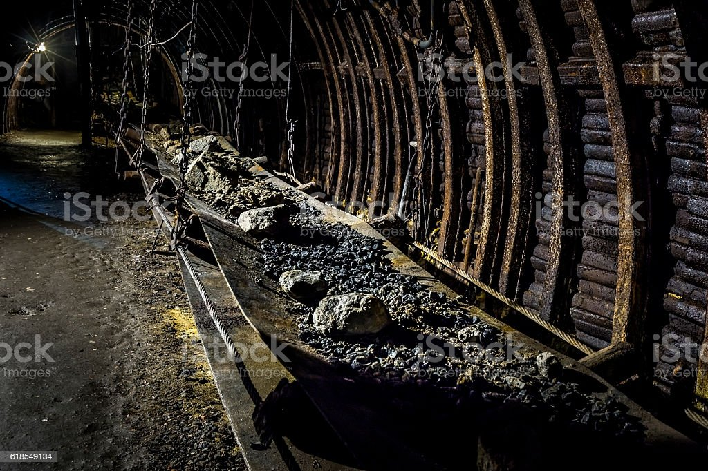 Coal mine underground corridor with conveyor system stock photo