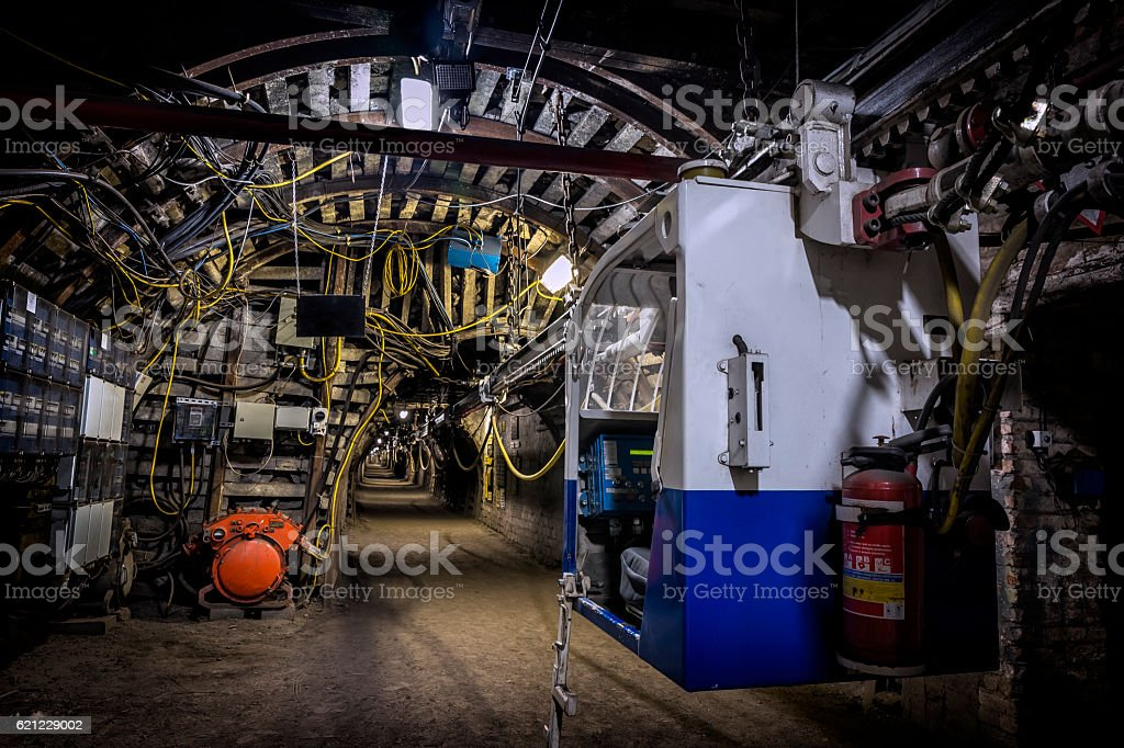Coal mine underground corridor with electric railway carriage stock photo