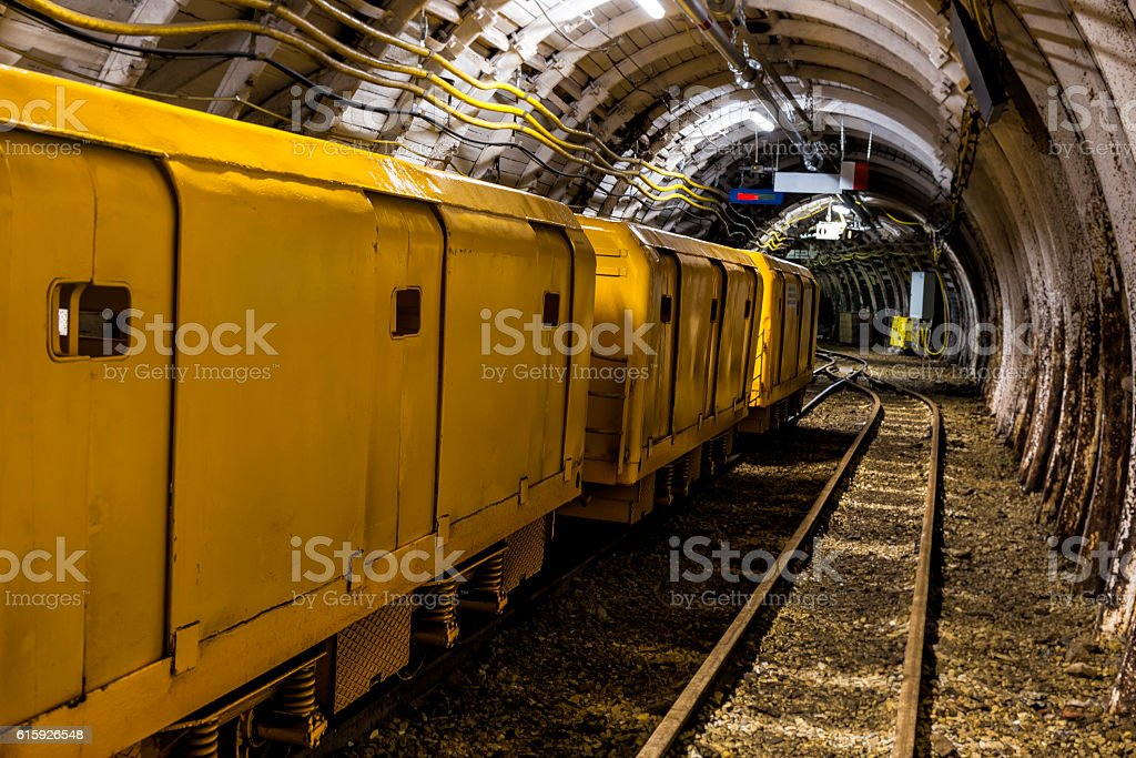 Coal mine underground corridor with electric train stock photo
