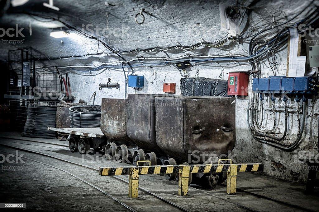 Coal mine underground corridor with railway carriages stock photo