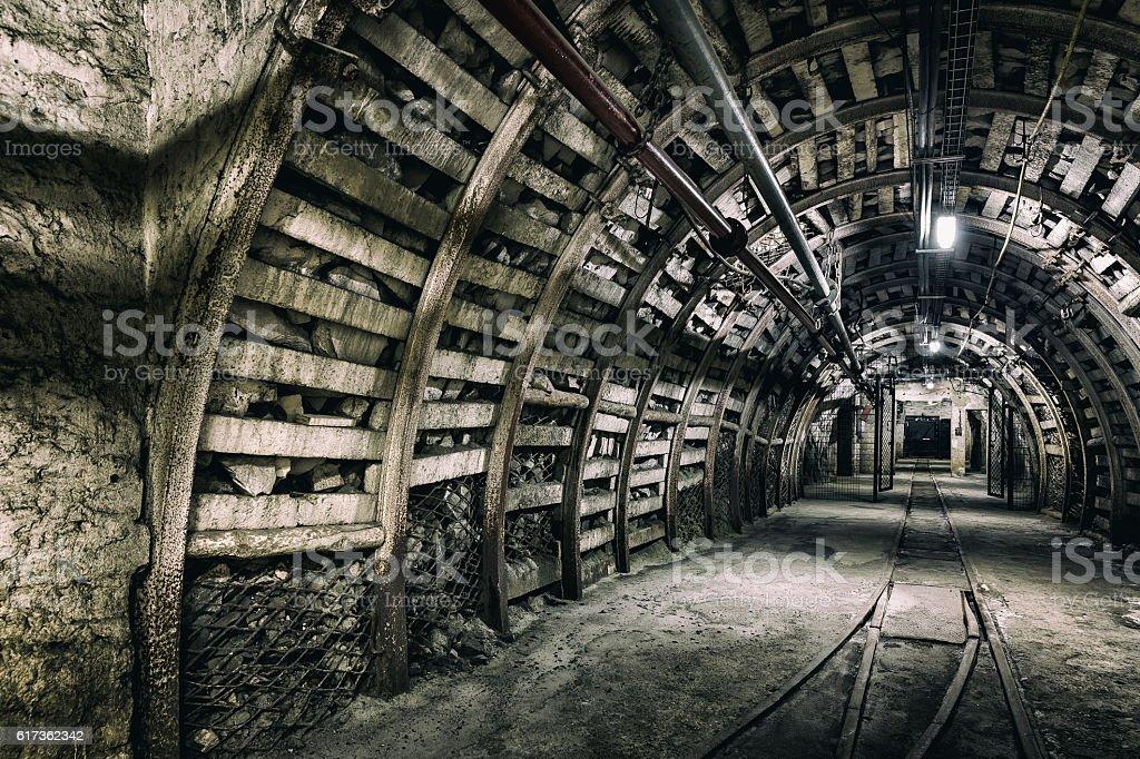 Coal mine underground corridor with steel support system stock photo