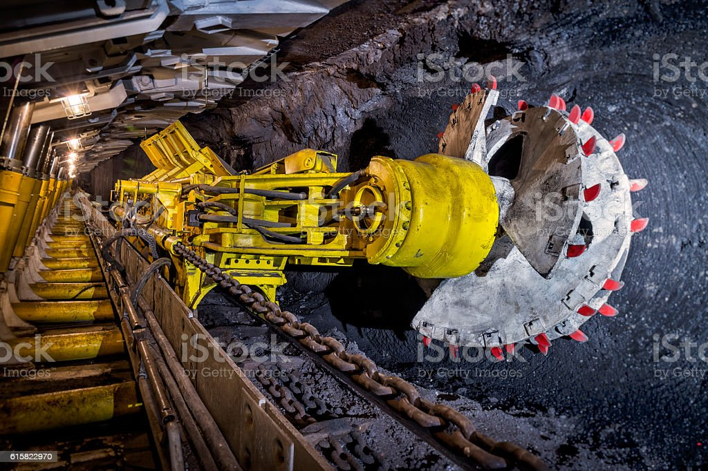 Coal mine underground corridor with support system and drilling machine stock photo