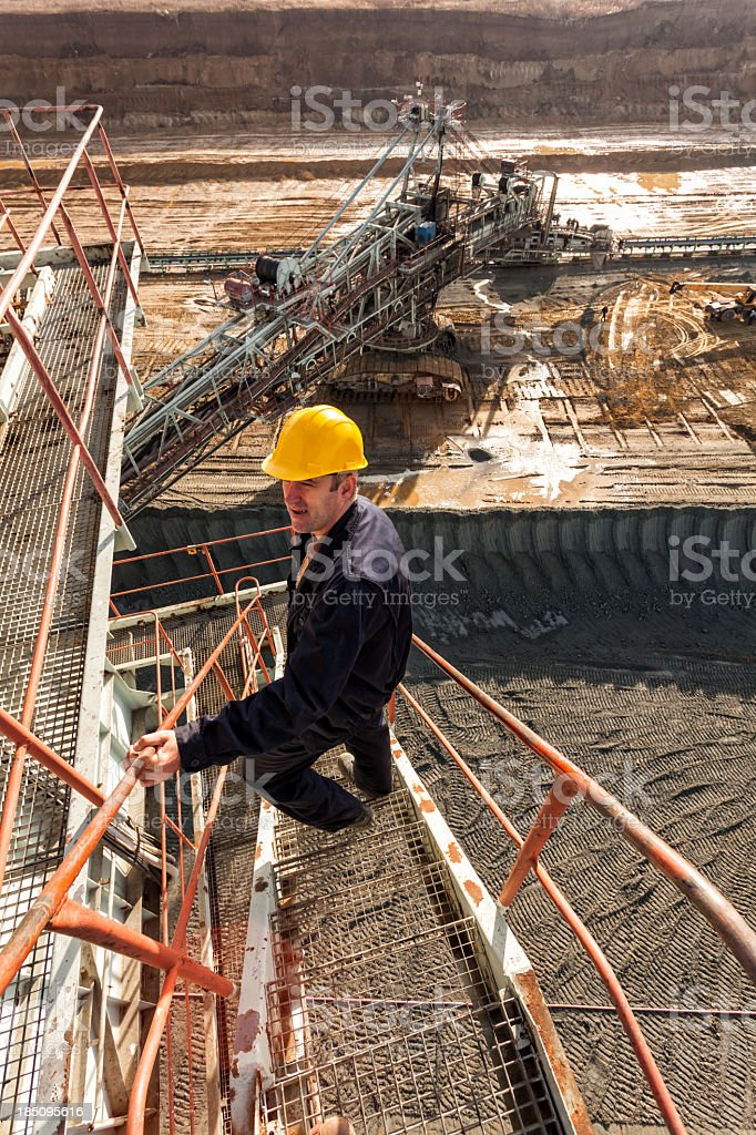 Coal mine worker wearing a hard hat on the job site stock photo