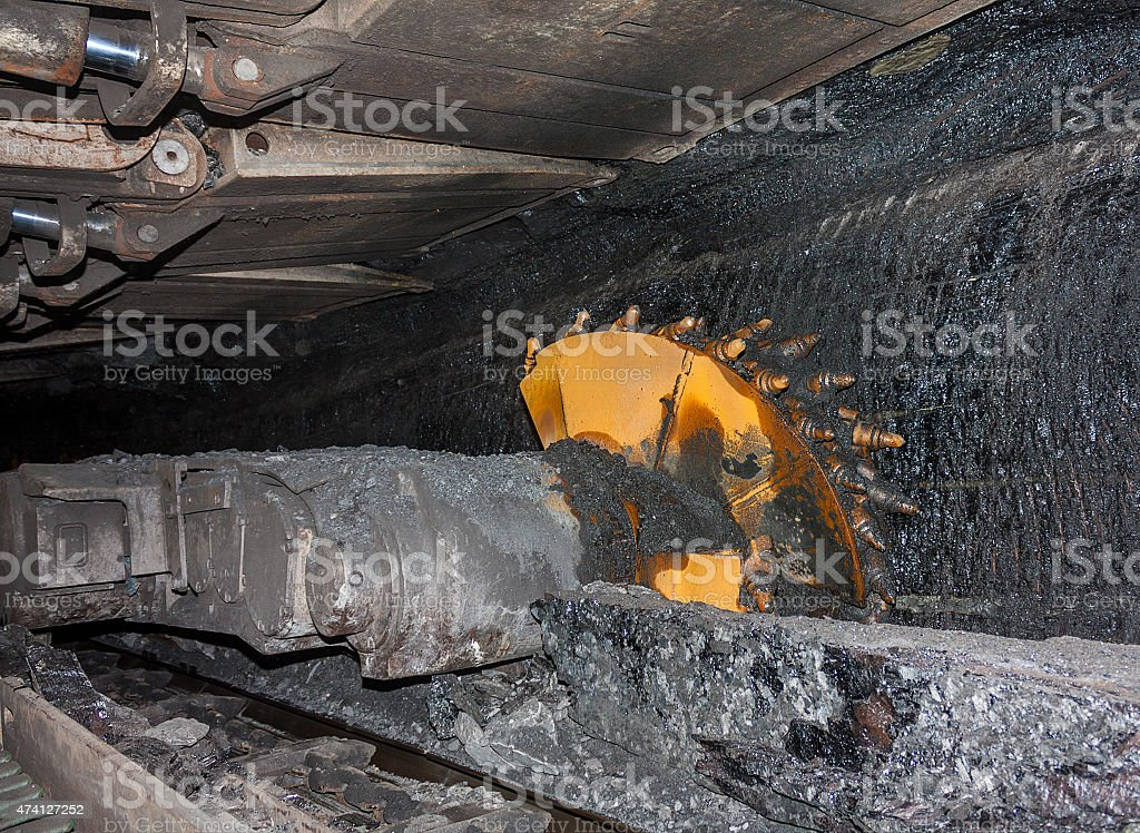 Coal mining machine with rotating cutting drums stock photo
