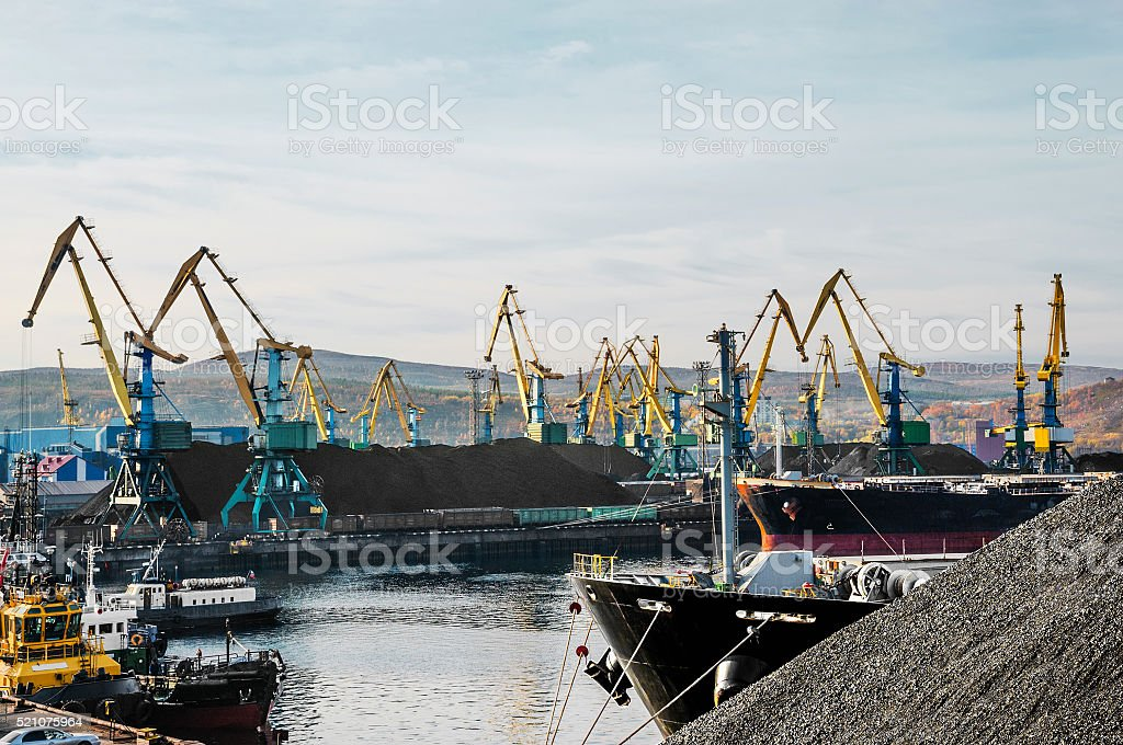 Coal Mountain in the sea commercial port. stock photo