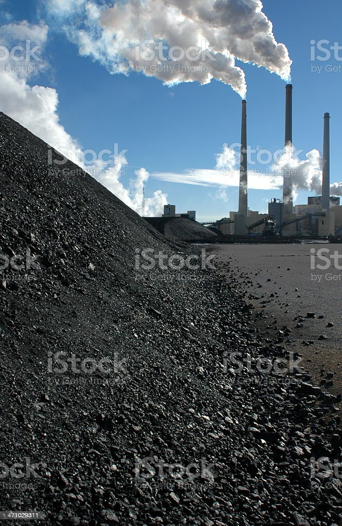 Coal Pile and Pollution stock photo