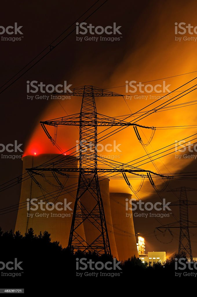 Coal power plant at night stock photo