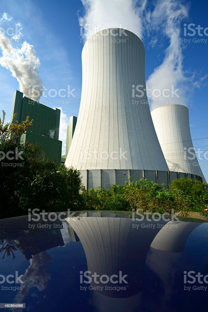 Coal Power Plant Smoking and Steaming against Blue Sky stock photo