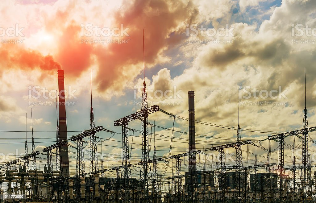 coal power plant with big chimneys and electrical substation stock photo