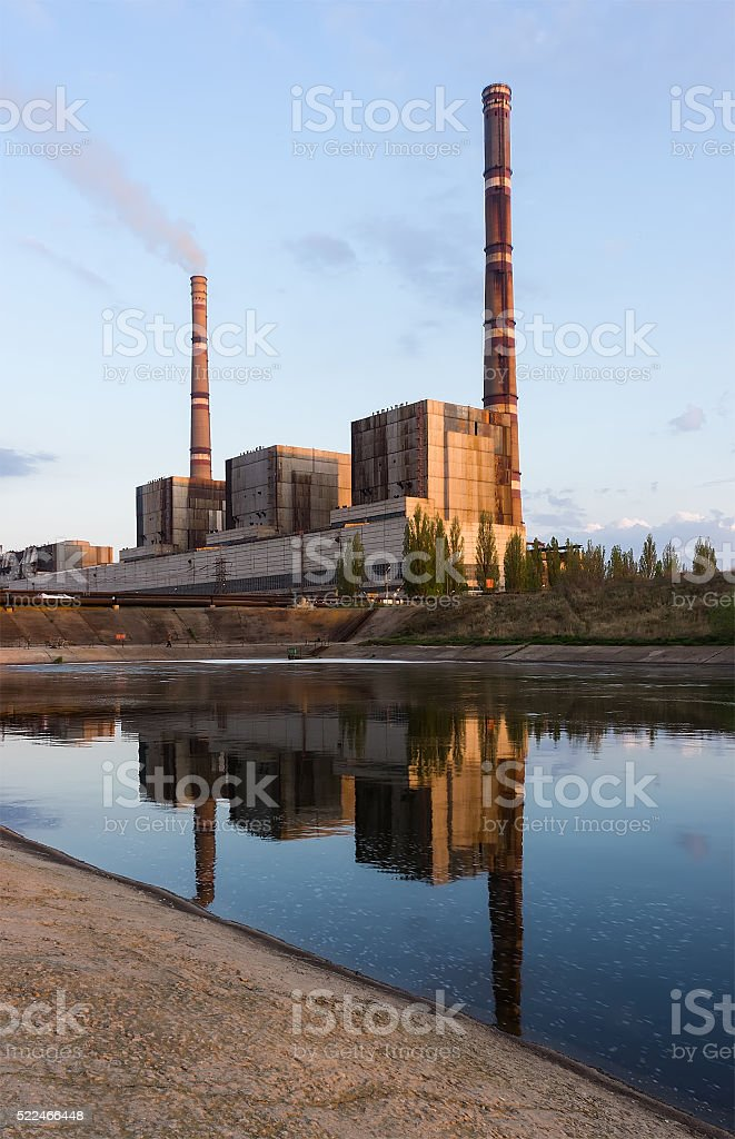 coal power plant with reflection at dusk, industrial landscape. stock photo