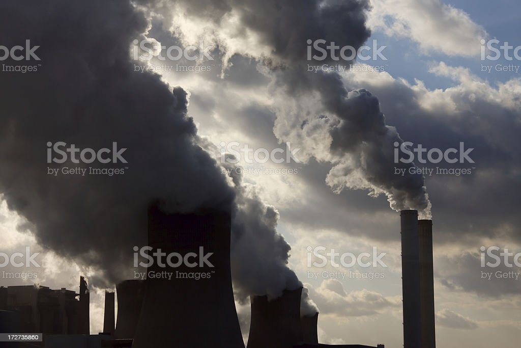 Coal power station burning fossil fuels stock photo