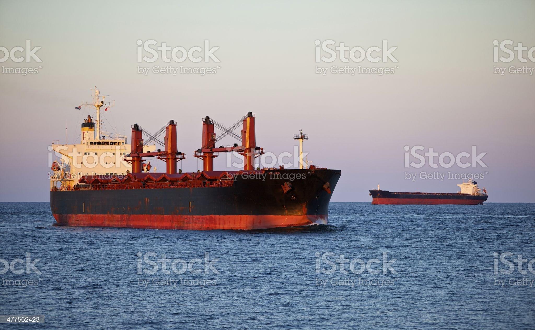 Coal ship entering Newcastle harbour royalty-free stock photo
