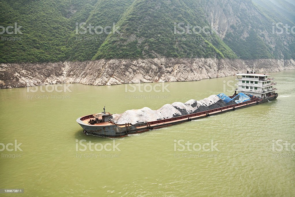 Coal ship sailing along the Yangtze river in China stock photo