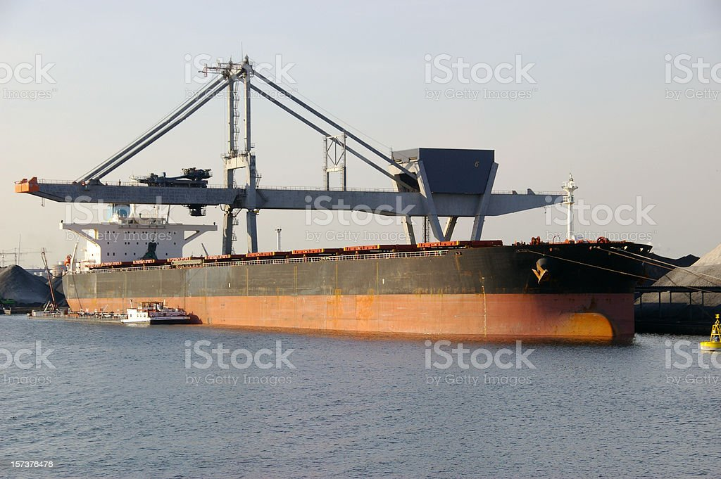 Coal ship unloading royalty-free stock photo