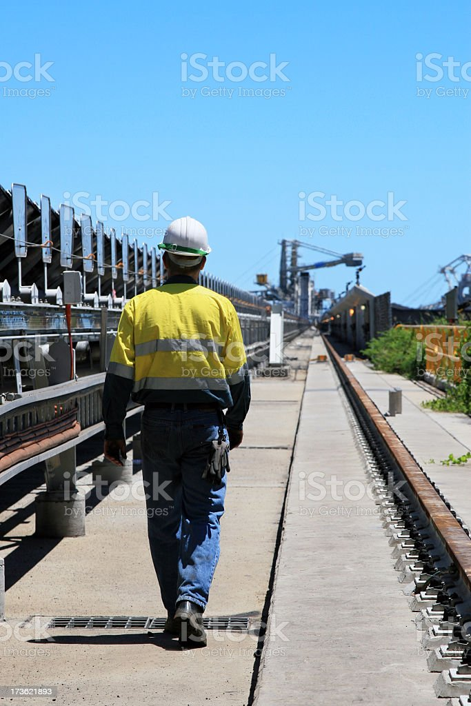 A coal terminal workman walking outdoors royalty-free stock photo