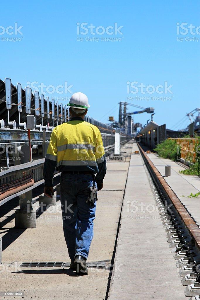 A coal terminal workman walking outdoors stock photo