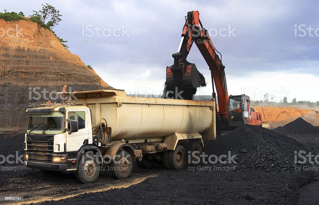 A coal truck being filled with coal stock photo