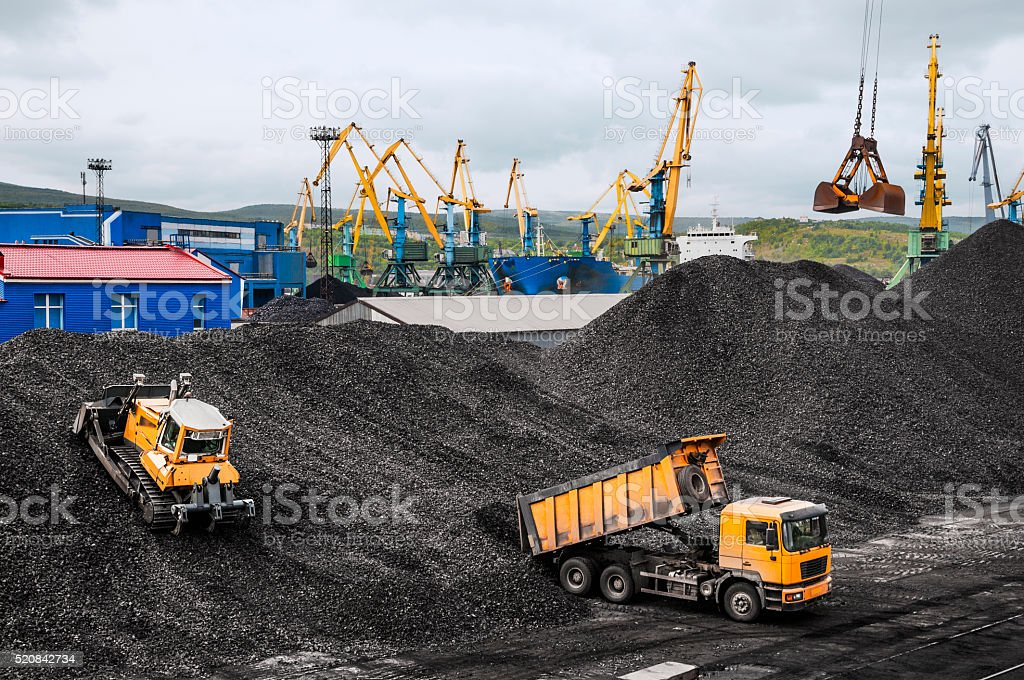 Coal warehouse in a commercial harbor stock photo