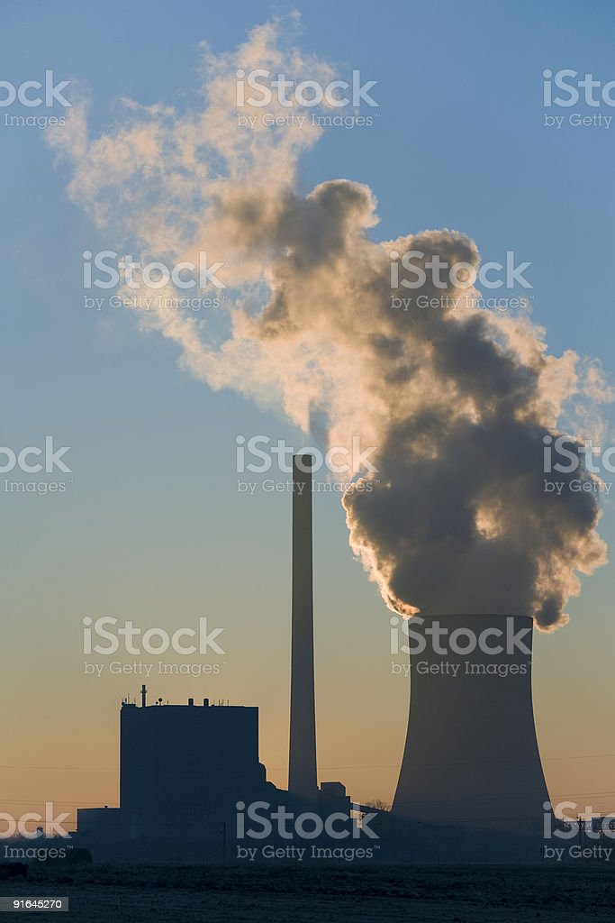 Coal-fired Power Station back lit at sunset royalty-free stock photo