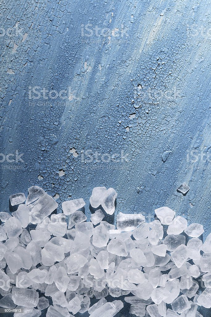 Coarse sea salt on old cracked painted background stock photo