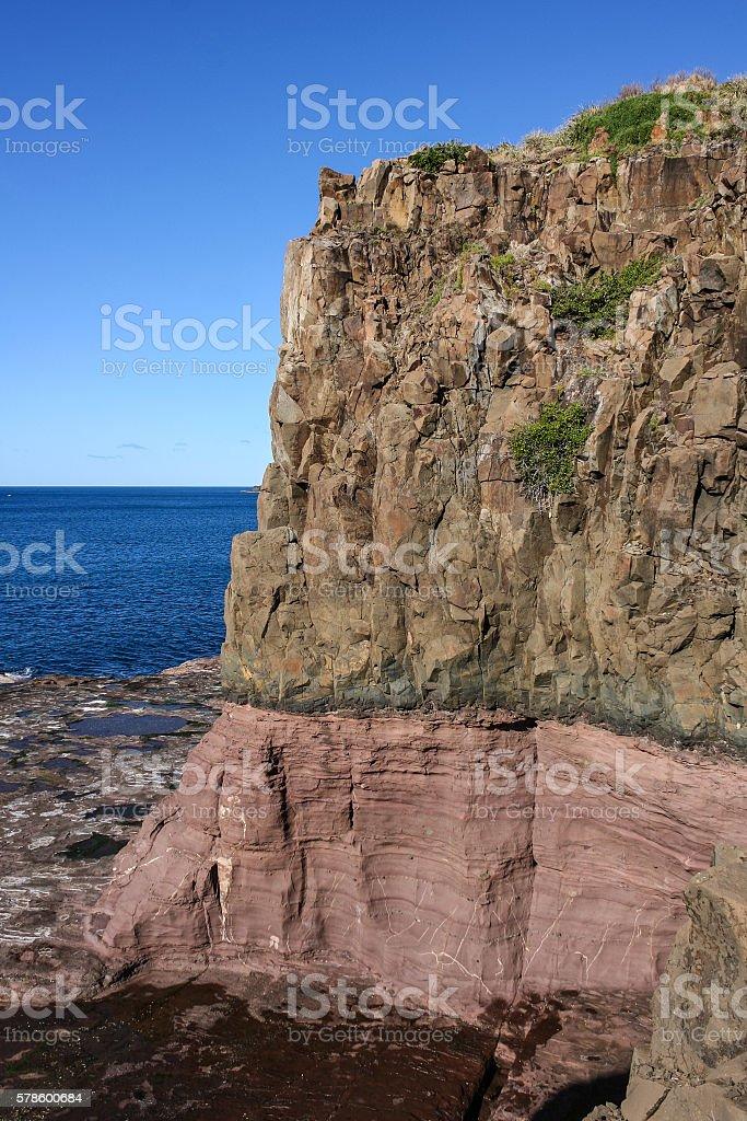 Coast and headland geological contact at Kiama Australia. stock photo