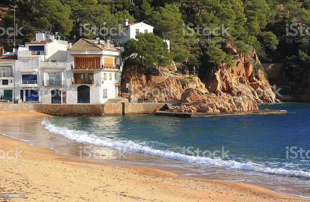 Coast and large home on Tamariu beach in Costa Brava Spain royalty-free stock photo